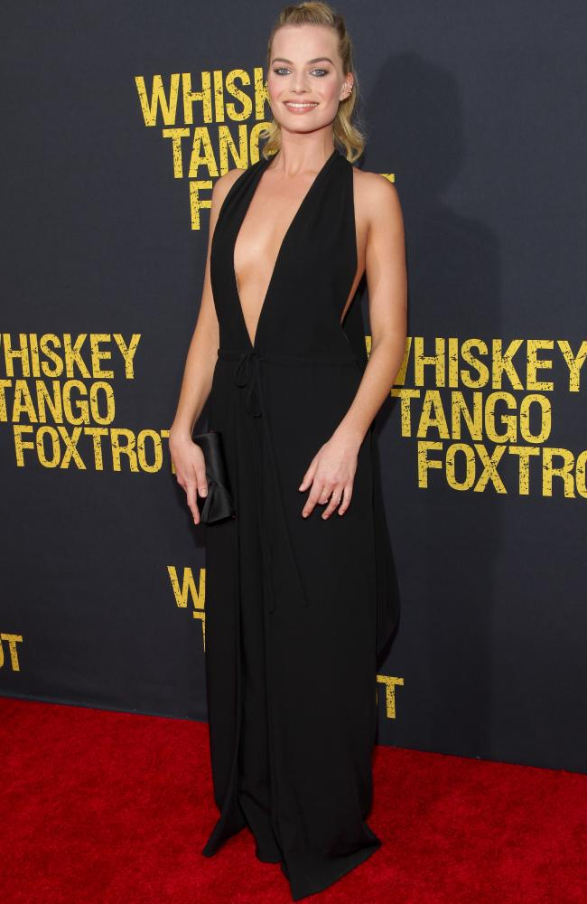 Margot Robbie and Stephen Peacocke walk the Whiskey Tango Foxtrot Red Carpet